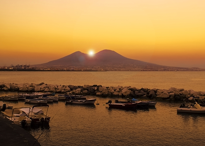 Sun rising right over Vesuvius, Naples, Italy